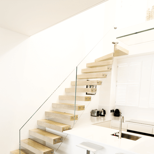 Floating staircase UK glass stairs exclusivestaircasescouk