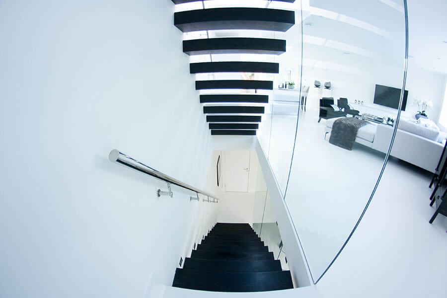 Black steps Floating stairs with polished chrome balustrade