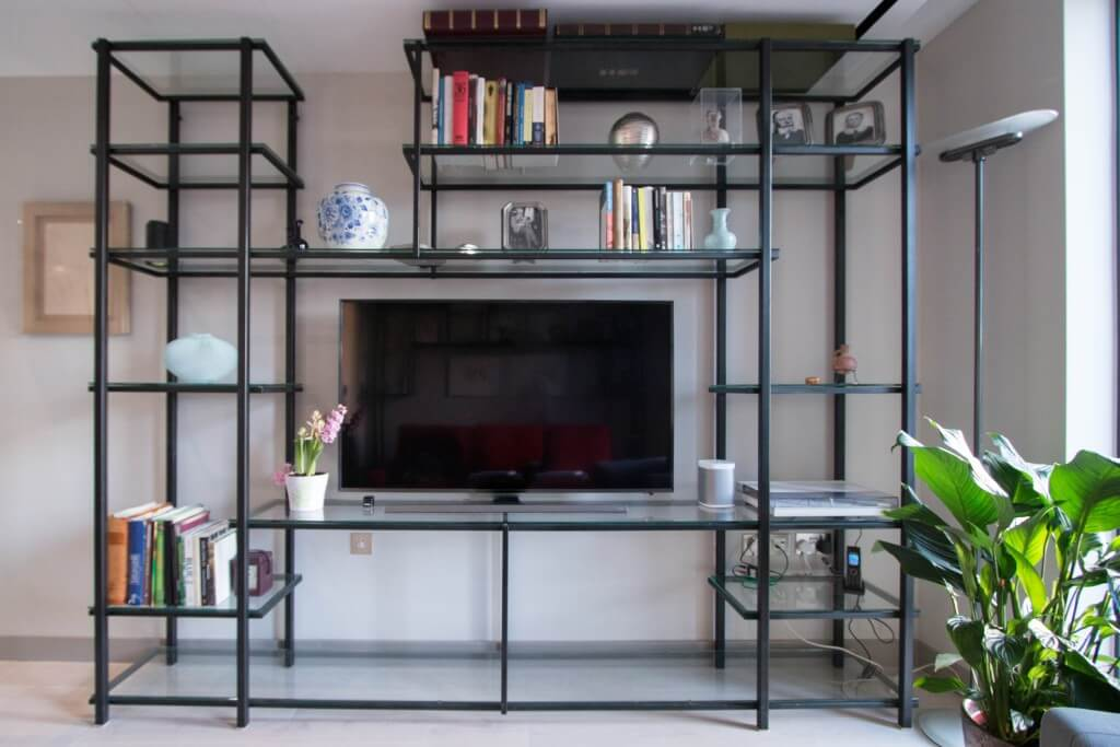 Metal shelving unit with glass panels
